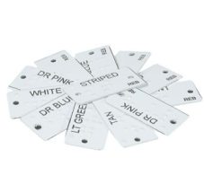"a pile of clothes labels with different clothing descriptors(e.g. ""striped"") printed in ink and braille"