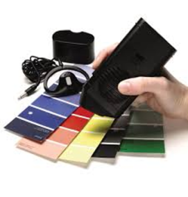 Talking Color detector reading the colors of a pile of blue, red, yellow, black, and green color swatches