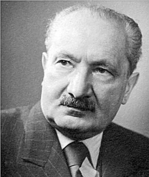 Black and white portrait photo of Martin Heidegger